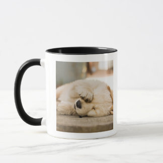 10 week old puppy rubbing its eyes mug