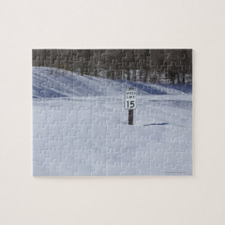 15 mph sign buried in snow jigsaw puzzle