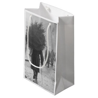 1915: A soldier carrying a christmas tree Small Gift Bag