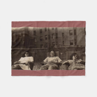1940s three people relaxing on the roof fleece blanket