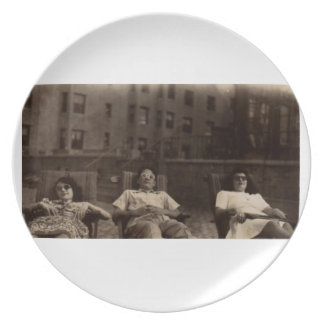 1940s three people relaxing on the roof plate