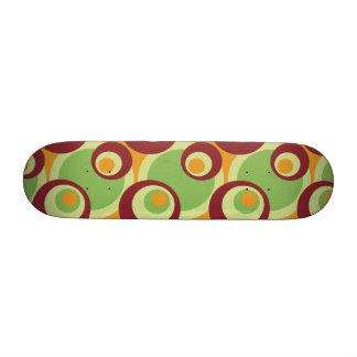1970s overlapping disco circles green orange custom skate board