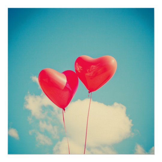 2 Bright Red Heart Shaped balloons Floating Upward