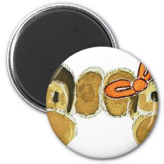 2 monkey heads orange bows 6 cm round magnet