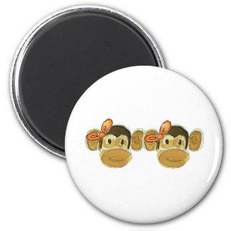 2 monkey heads orange bows fridge magnets
