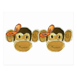 2 monkey heads orange bows postcard