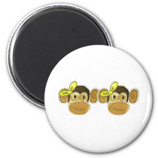 2 monkey heads yellow bows 6 cm round magnet
