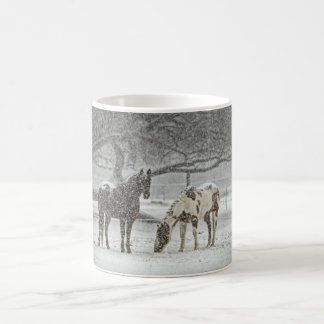 2 Snowy Horses Standing Under a Tree in Winter Mug