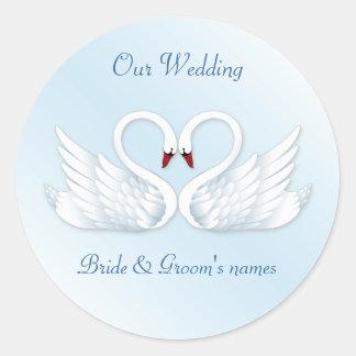 2 stylised white swans round sticker