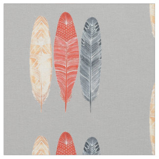 3 Feathers on Gray Fabric