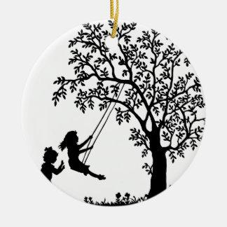 3 Girls, Swinging on Tree Swing & Picking Flowers Round Ceramic Decoration