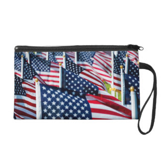 400 flags waving proudly in a field wristlet clutches