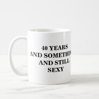 40 YEARS AND SOMETHINGAND STILL SEXY BASIC WHITE MUG