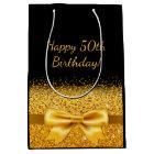 50th birthday on black with gold bow sparkle medium gift bag