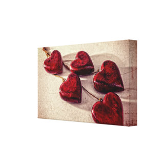 5 Red Wooden Hearts Entwined Together Stretched Canvas Print