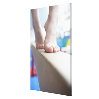6-7 year old girl slowly walks across balance canvas print