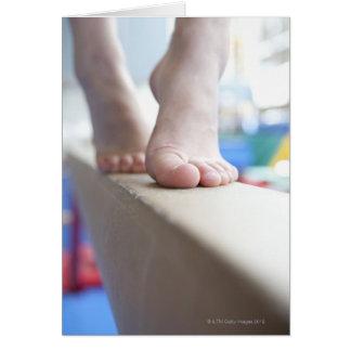 6-7 year old girl slowly walks across balance card