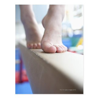 6-7 year old girl slowly walks across balance postcard