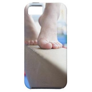 6-7 year old girl slowly walks across balance tough iPhone 5 case