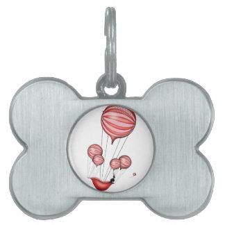 6) loss - tony fernandes pet ID tag