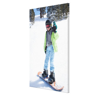 9 years old girl snowboarding canvas print