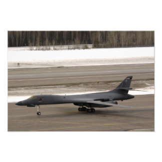 A B-1B Lancer performs a touch and go Photo Print