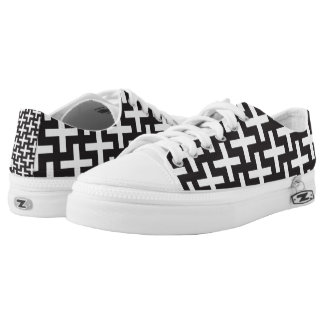 A b&w patterns made with 'plus' sign printed shoes