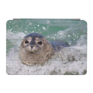 A baby seal surfing iPad mini cover