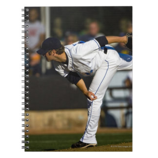 A baseball playing throwing the ball notebook