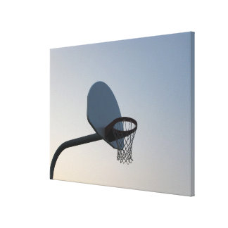 A basketball backboard hoop and net. Clear blue Canvas Print