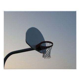 A basketball backboard hoop and net. Clear blue Poster
