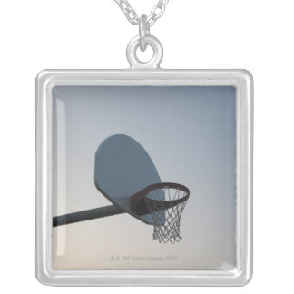 A basketball backboard hoop and net. Clear blue Silver Plated Necklace