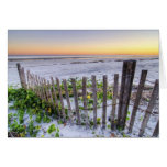 A Beach Fence at Sunset Greeting Cards