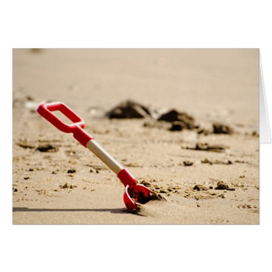 A beach spade. card