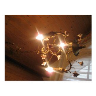 A beautiful chandelier inside a hotel room postcard