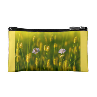 A bee on the Spring wild flowers Makeup Bags