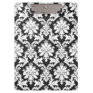 A BLACK AND WHITE DAMASK DESIGN CLIPBOARD