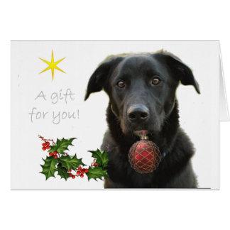 A Black Labrador retriever bringing gift Greeting Card