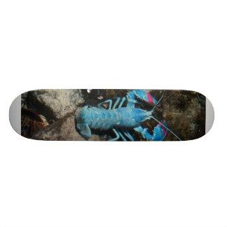 A blue lobster on the bottom of skateboard. skateboard deck