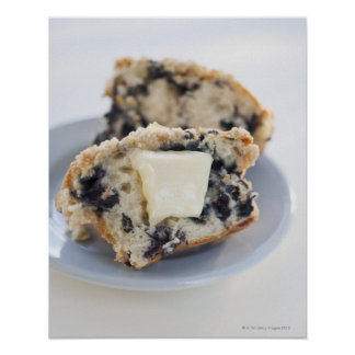 A blueberry muffin with butter poster