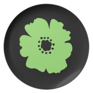 A Bold Green Flower on Black Plate