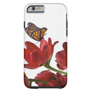 a bouquet of red tulips is visited by a monarch tough iPhone 6 case