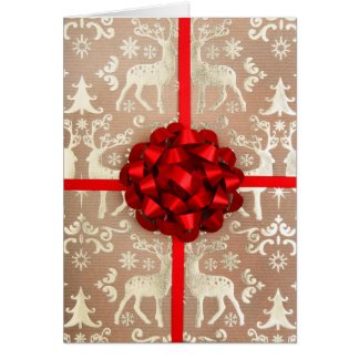 A bow and ribbon on Christmas wrapping paper Card