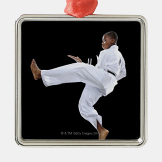 A Boy (15 Years Old) doing a front kick Silver-Colored Square Decoration