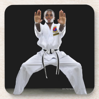 A Boy (15 Years Old) in a Karate Uniform with Coaster