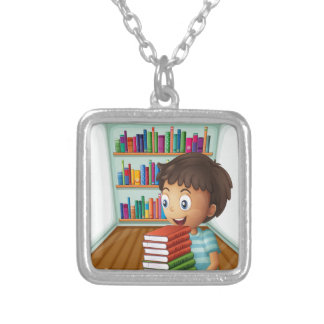 A boy carrying a pile of books square pendant necklace