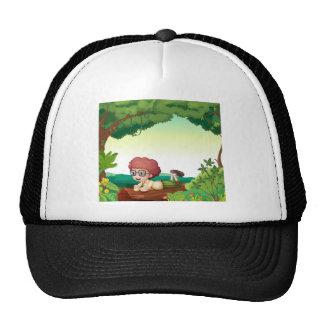 A boy lying on a dry wood cap