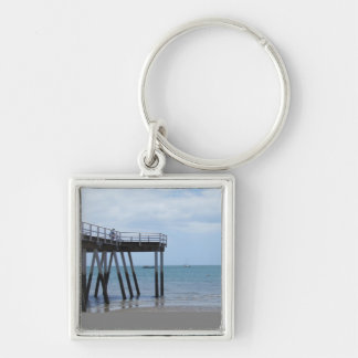 A Boy on a Bike at the Hervey Bay Ocean Pier. Silver-Colored Square Key Ring