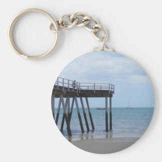 A Boy on a Bike at the Hervey Bay Ocean Pier. Basic Round Button Key Ring