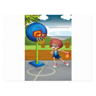 A boy playing basketball postcard